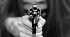 Gun-Girl-Points-a-38-Caliber-Snub-Nose-Revolver-Weapon-Right-at-The-Viewer-via-Shutterstock-800x430